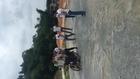 Ten men riding a motorcycle
