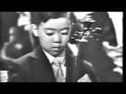 Leonard Bernstein presents 7-year-old Yo-Yo Ma's high-profile debut for President John F. Kennedy